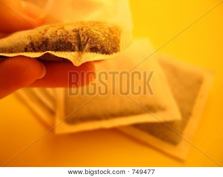 Teabags And Hand