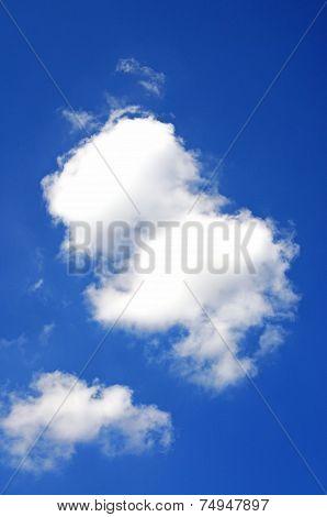 White cumulus clouds and blue sky.