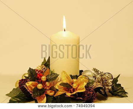 Christmas candle with decorations.