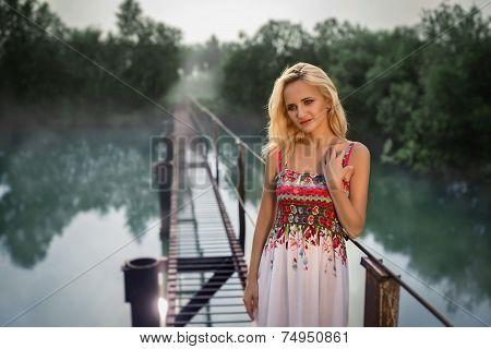 Beautiful girl on pond