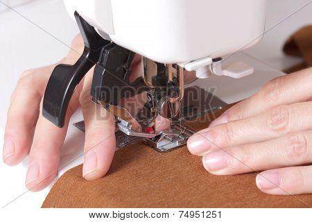 Woman Sews