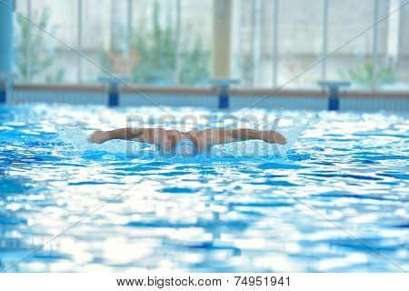 health and fitness lifestyle concept with young athlete swimmer recreating  on indoor olimpic pool