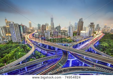 Shanghai, China cityscape obove highway junctions.
