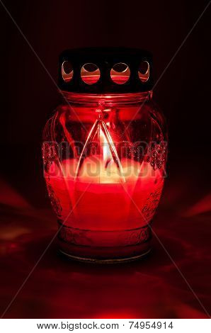 Red Burning Votive Candle In The Dark