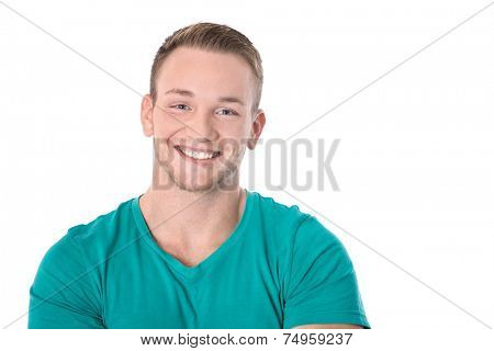 Happy isolated young blond man in green shirt smiling: white teeth.