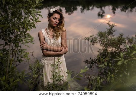 Beautiful girl in a pond