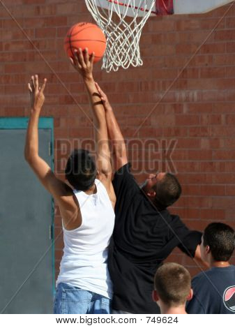 Boys Reaching for Basket