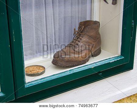 an old shoe in a window