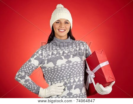Portrait of happy female with red giftbox looking at camera