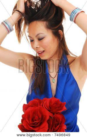 Asian girl pulling her hair.
