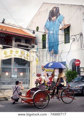 Tourists Taking Photo In Front Of Famous Street Art Mural In Georgetown, Penang, Malaysia
