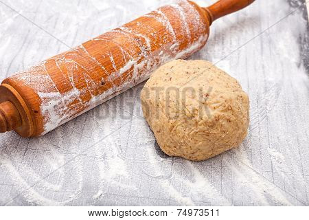 Wooden Rolling Pin And A Dough Ball
