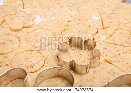 Cookie Cutters On Fresh Cookie Dough