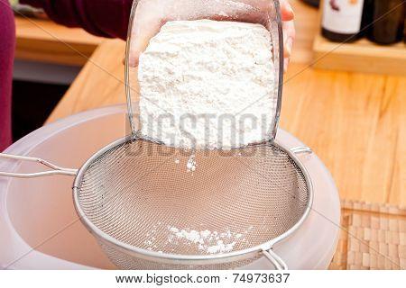 Put Flour Of Glass Bowl Through A Flour Sieve