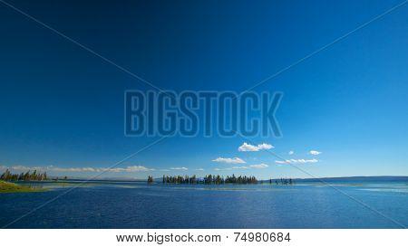 Small Island In Blue Lake