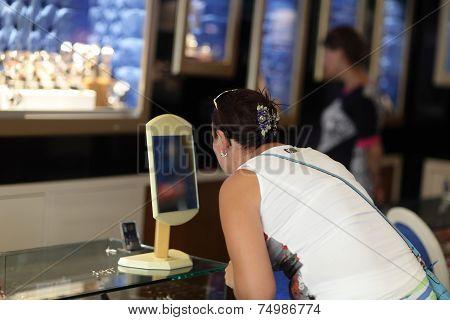 Girl Choosing Earrings
