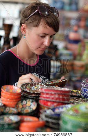Woman In Souvenir Shop