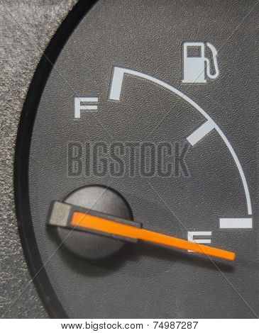 Fuel gauge dash board close up showing empty