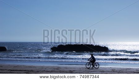 Cyclist On The Shore.