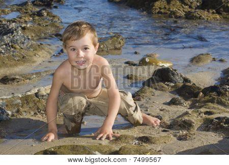 Boy with sandy hands on the beach