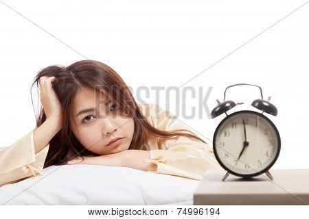 Sleepy Asian Girl  Wake Up  With Pillow And Alarm Clock