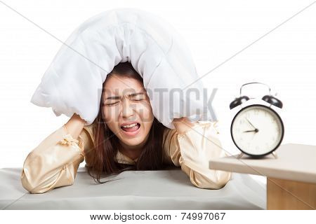 Sleepy Asian Girl Use Pillow Cover Ears And Alarm Clock