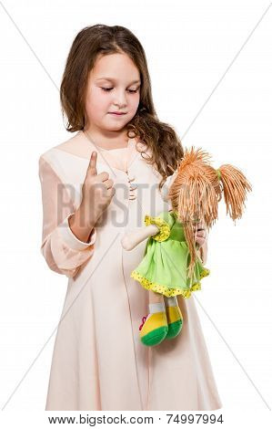 Girl Playing With Her Doll