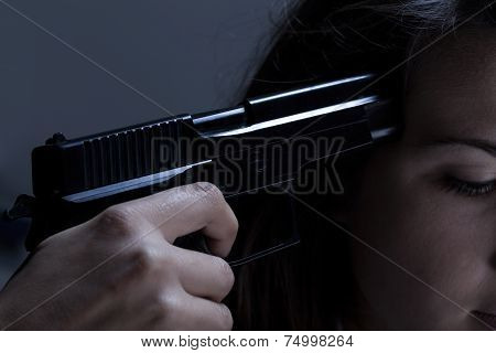 Close-up Of Woman Holding Gun