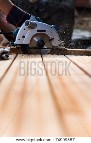 Building a patio with wooden terrace and stones