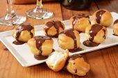 image of cream puff  - Mini cream puffs with vanilla custard filling and chocolate sauce - JPG