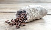 picture of sackcloth  - Coffee Beans In The Sackcloth Bag On The Wooden Table - JPG