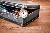 foto of old suitcase  - Old suitcase with old alarm clock and old shirt - JPG