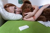 picture of teen pregnancy  - Sad scared teen realized that she is expecting a baby - JPG