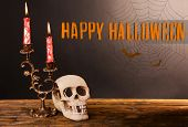 pic of bloody  - Bloody candles for Halloween holiday and decorative skull on pumpkin - JPG