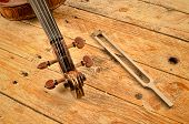 picture of tuning fork  - Violin neck and a tuning fork a musical concept - JPG