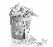 stock photo of dustbin  - Money in dustbin isolated on white - JPG