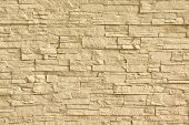 stock photo of wall-stone  - Beige Artificial Stone Wall - JPG