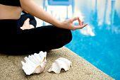 stock photo of padmasana  - Yoga Meditation hand by pool lotus pose  - JPG