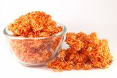 stock photo of crispy rice  - Red Sweet crispy noodles in a glass make from rice - JPG
