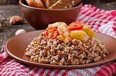 image of porridge  - Buckwheat porridge with chicken and vegetables on plate - JPG