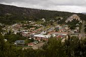 foto of denude  - Mining town Queestown with brightly coloured houses and denuded hills from intense mining - JPG