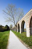stock photo of aqueduct  - Country road along a roman aqueduct  - JPG