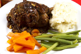 picture of lamb shanks  - Cooked lamb shanks with gravy and vegetables - JPG