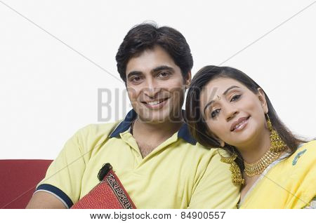 Couple sitting on a couch and smiling