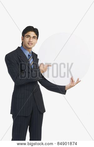 Businessman holding a blank disc