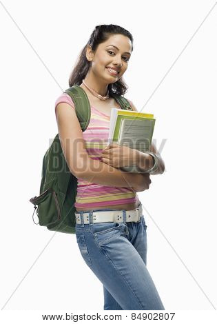 Portrait of a female college student holding files