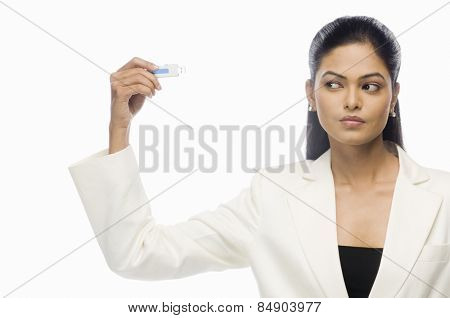 Businesswoman looking at a flash drive