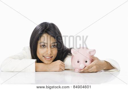 Portrait of a businesswoman with a piggy bank