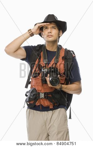 Young male photographer holding a digital camera