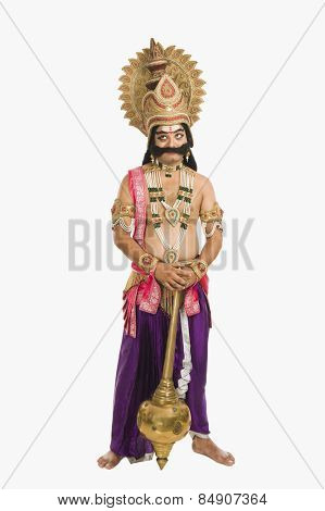 Stage artist dressed-up as Ravana and holding a mace
